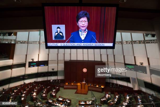 Carrie Lam Hong Kong's chief executive is shown on a screen as she speaks during a questionandanswer session in the chamber of the Legislative...