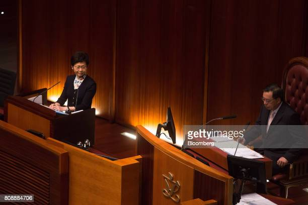 Carrie Lam Hong Kong's chief executive left looks on as Andrew Leung president of the Legislative Council speaks during a questionandanswer session...