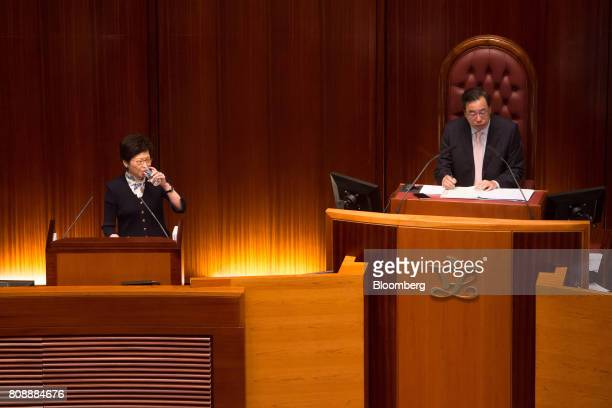 Carrie Lam Hong Kong's chief executive left takes a drink of water during a questionandanswer session in the chamber of the Legislative Council in...