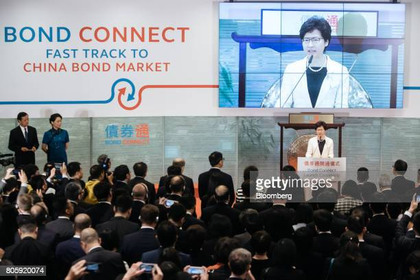 Carrie Lam Hong Kong's chief executive right speaks during the launch ceremony of the ChinaHong Kong Bond Connect at the Hong Kong Stock Exchange in...
