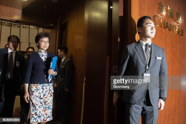 Carrie Lam Hong Kong's chief executive second left leaves the chamber following a questionandanswer session at the Legislative Council in Hong Kong...
