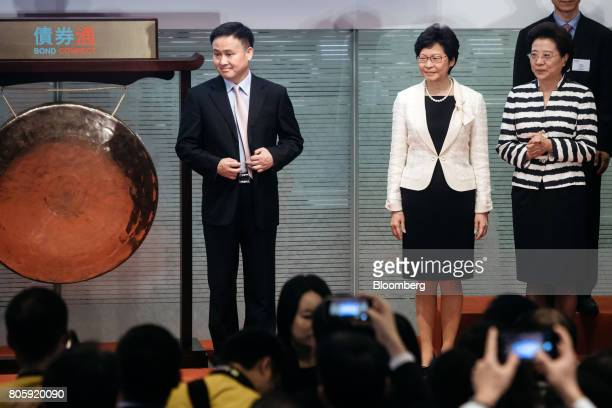 Carrie Lam Hong Kong's chief executive second right and Pan Gongsheng deputy governor of the People's Bank of China left attend the launch ceremony...