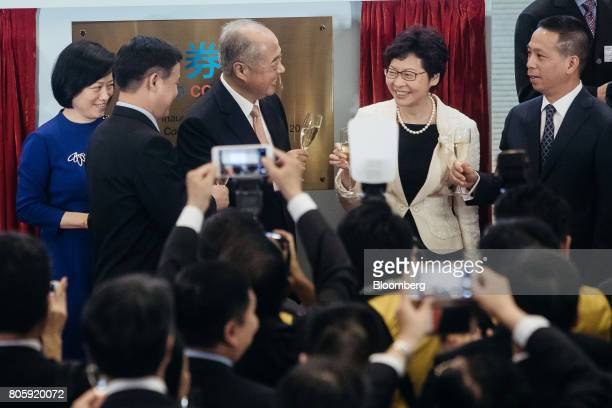 Carrie Lam Hong Kong's chief executive second right Chow ChungKong chairman of Hong Kong Exchanges Clearing Ltd third left and Pan Gongsheng deputy...