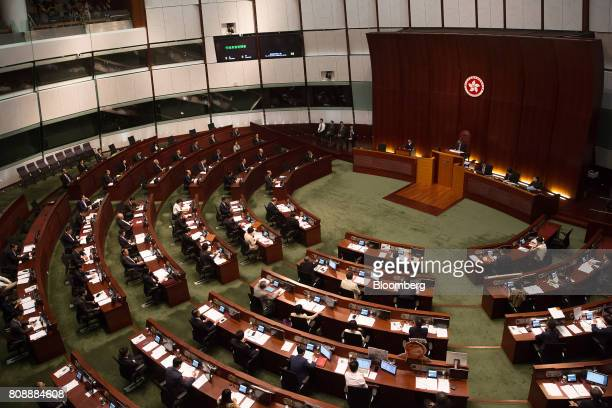 Carrie Lam Hong Kong's chief executive standing at rear bench speaks during a questionandanswer session in the chamber of the Legislative Council in...