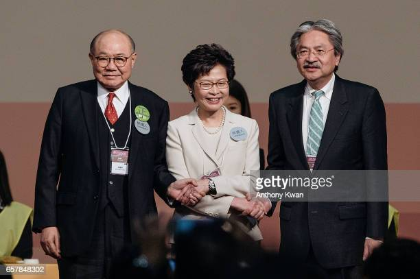 Carrie Lam Hong Kong's chief executiveelect center stands on stage with candidates for Hong Kong's chief executive John Tsang Hong Kong's former...