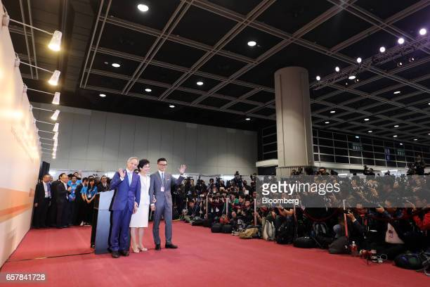 Carrie Lam Hong Kong's chief executiveelect center with her husband Lam Siupor left and son Lam Jitsi stand for photographs at a news conference...