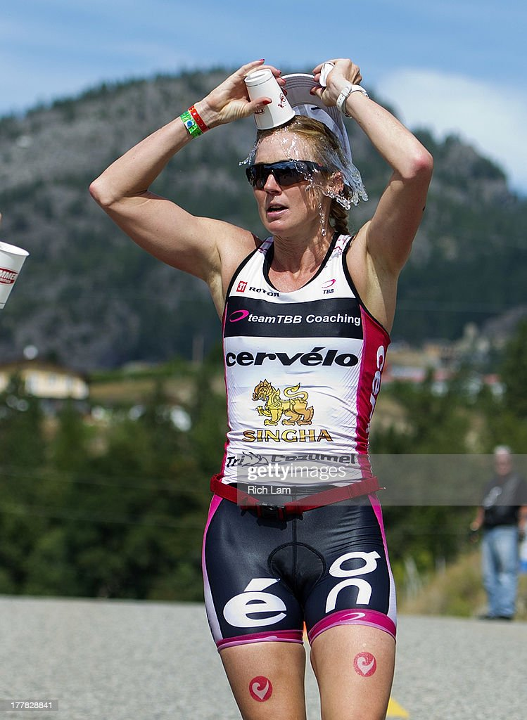 Carrie Lester pours water onto herself while on the the run portion of the Challenge Penticton Triathlon on August 25, 2013 in Penticton, British Columbia, Canada.