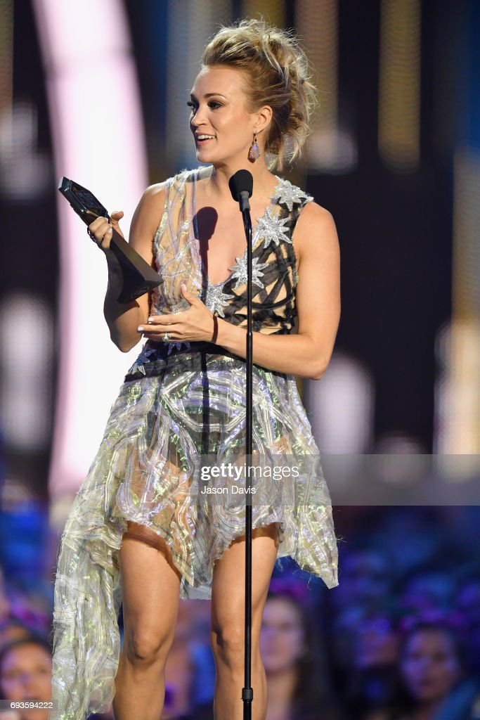 Carrie Underwood accepts an award onstage at the 2017 CMT Music Awards at the Music City Center on June 7, 2017 in Nashville, Tennessee.