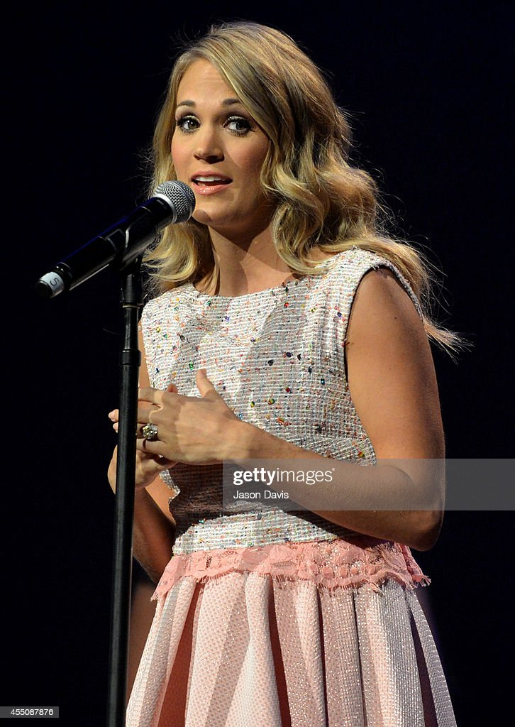 Carrie Underwood accepts the Gene Weed Special Achievement Award at the 8th Annual ACM Honors at the Ryman Auditorium on September 9 2014 in...