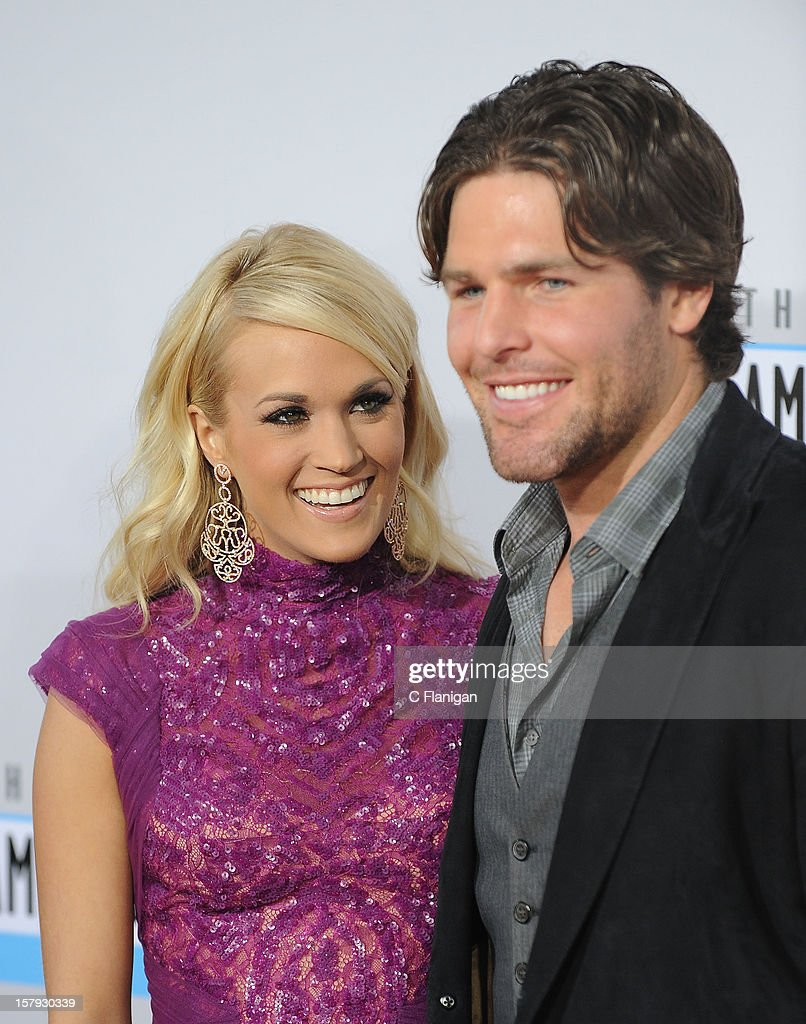 Carrie Underwood and husband Mike Fisher (L) arrive at The 40th American Music Awards at Nokia Theatre L.A. Live on November 18, 2012 in Los Angeles, California.