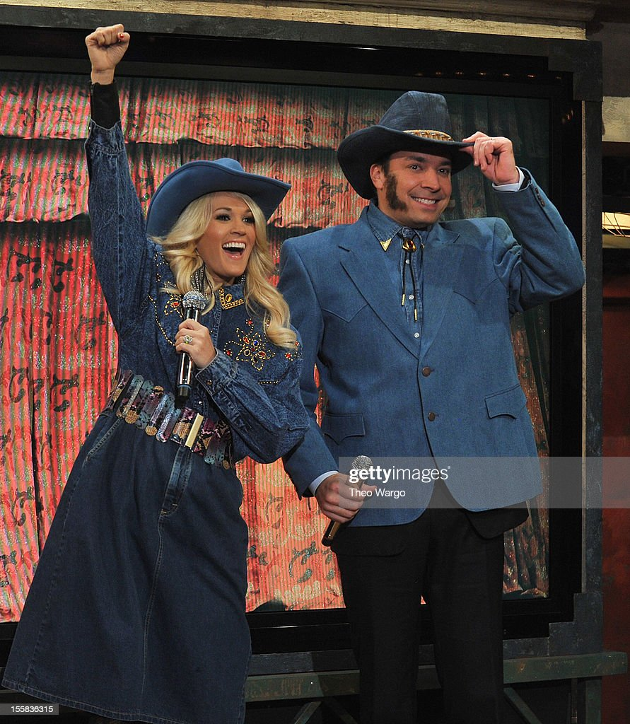 Carrie Underwood and Jimmy Fallon perform a skit during a taping of 'Late Night With Jimmy Fallon' at Rockefeller Center on November 8, 2012 in New York City.