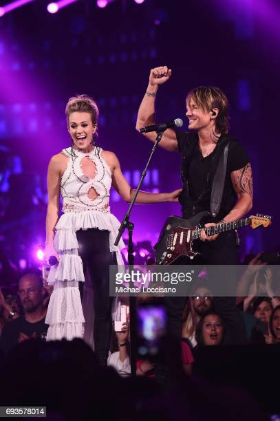Carrie Underwood and Keith Urban perform onstage during the 2017 CMT Music Awards at the Music City Center on June 6 2017 in Nashville Tennessee