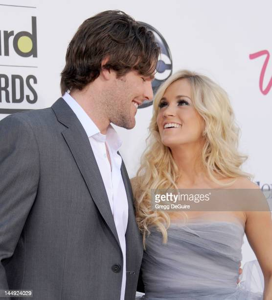 Carrie Underwood and Mike Fisher arrive at the 2012 Billboard Music Awards at MGM Grand on May 20 2012 in Las Vegas Nevada