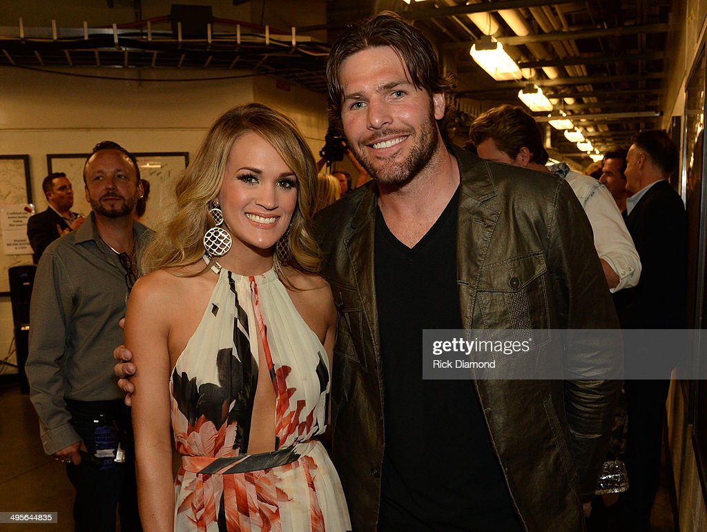 <a gi-track='captionPersonalityLinkClicked' href=/galleries/search?phrase=Carrie+Underwood&family=editorial&specificpeople=204483 ng-click='$event.stopPropagation()'>Carrie Underwood</a> and <a gi-track='captionPersonalityLinkClicked' href=/galleries/search?phrase=Mike+Fisher&family=editorial&specificpeople=204732 ng-click='$event.stopPropagation()'>Mike Fisher</a> attend the 2014 CMT Music Awards at Bridgestone Arena on June 4, 2014 in Nashville, Tennessee.