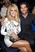 Carrie Underwood and Mike Fisher attend the 2015 CMT Music awards at the Bridgestone Arena on June 10 2015 in Nashville Tennessee