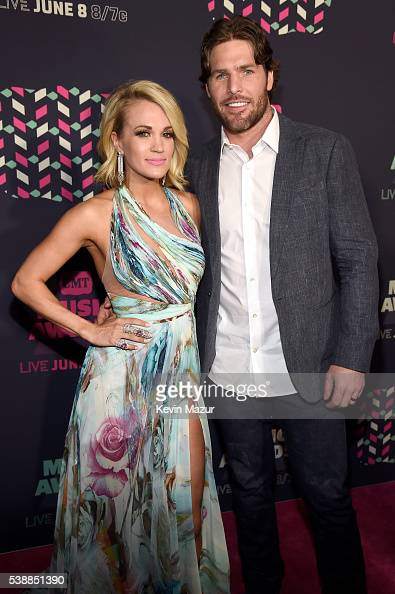 Carrie Underwood and Mike Fisher attend the 2016 CMT Music awards at the Bridgestone Arena on June 8 2016 in Nashville Tennessee