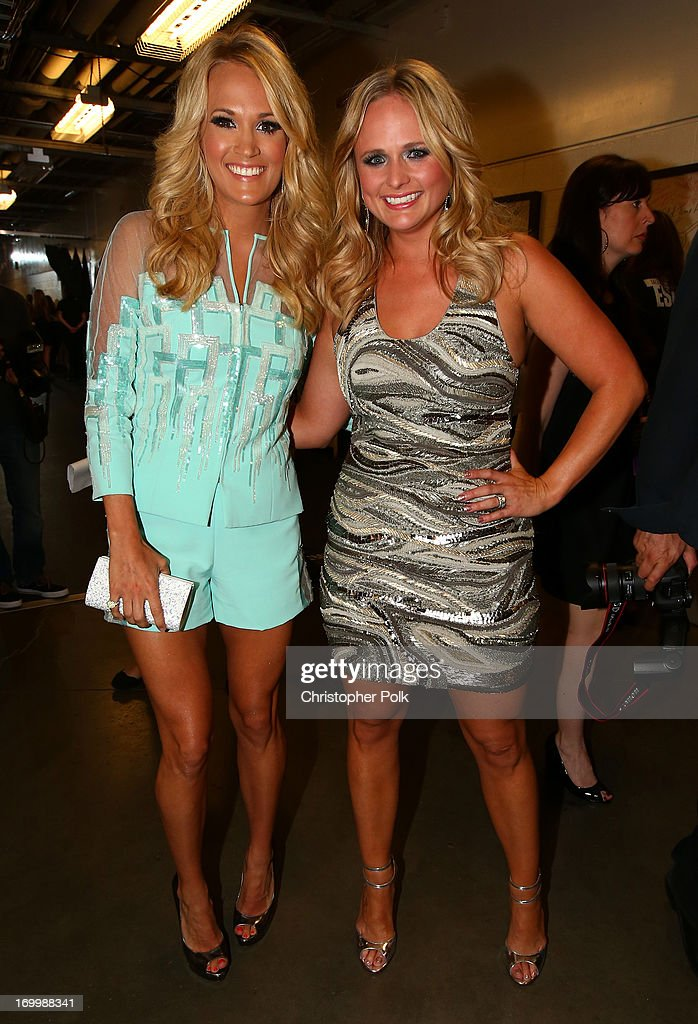 <a gi-track='captionPersonalityLinkClicked' href=/galleries/search?phrase=Carrie+Underwood&family=editorial&specificpeople=204483 ng-click='$event.stopPropagation()'>Carrie Underwood</a> (L) and <a gi-track='captionPersonalityLinkClicked' href=/galleries/search?phrase=Miranda+Lambert&family=editorial&specificpeople=571972 ng-click='$event.stopPropagation()'>Miranda Lambert</a> attend the 2013 CMT Music awards at the Bridgestone Arena on June 5, 2013 in Nashville, Tennessee.