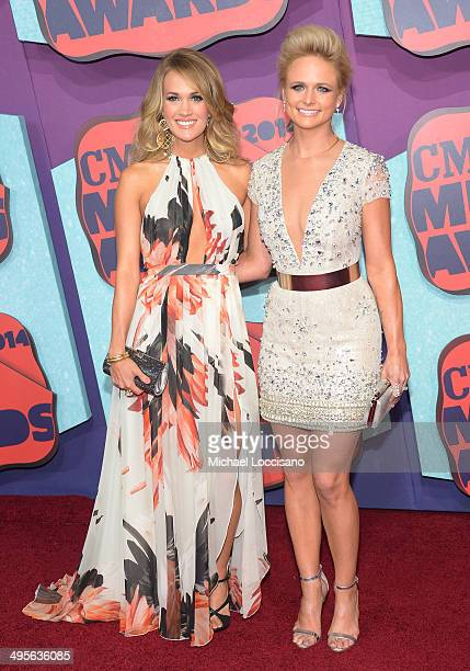 Carrie Underwood and Miranda Lambert attend the 2014 CMT Music awards at the Bridgestone Arena on June 4 2014 in Nashville Tennessee