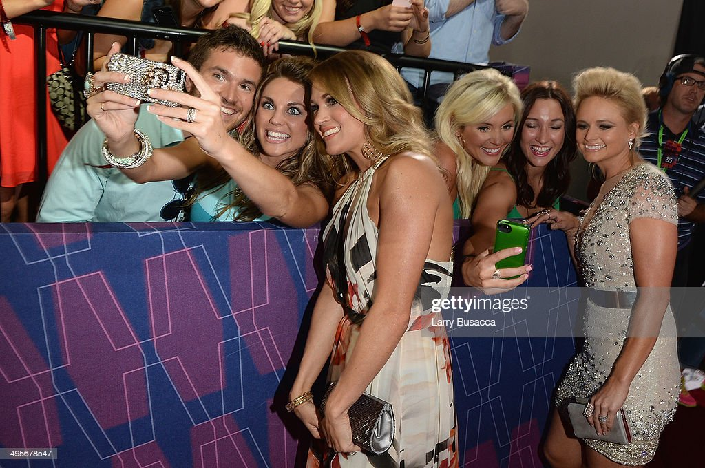 <a gi-track='captionPersonalityLinkClicked' href=/galleries/search?phrase=Carrie+Underwood&family=editorial&specificpeople=204483 ng-click='$event.stopPropagation()'>Carrie Underwood</a> (L) and <a gi-track='captionPersonalityLinkClicked' href=/galleries/search?phrase=Miranda+Lambert&family=editorial&specificpeople=571972 ng-click='$event.stopPropagation()'>Miranda Lambert</a> attend the 2014 CMT Music awards at the Bridgestone Arena on June 4, 2014 in Nashville, Tennessee.