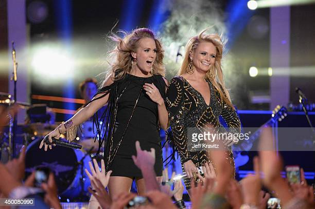 Carrie Underwood and Miranda Lambert perform during the 2014 CMT Music awards at the Bridgestone Arena on June 4 2014 in Nashville Tennessee