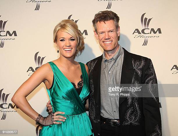 Carrie Underwood and Randy Travis arrive at the 2nd Annual ACM Honors at the Schermerhorn Symphony Center on September 22 2009 in Nashville Tennessee