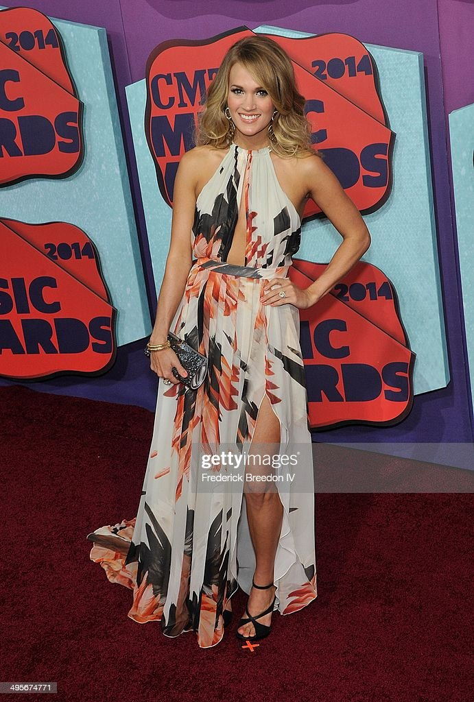 <a gi-track='captionPersonalityLinkClicked' href=/galleries/search?phrase=Carrie+Underwood&family=editorial&specificpeople=204483 ng-click='$event.stopPropagation()'>Carrie Underwood</a> arrives at the 2014 CMT Music awards at the Bridgestone Arena on June 4, 2014 in Nashville, Tennessee.