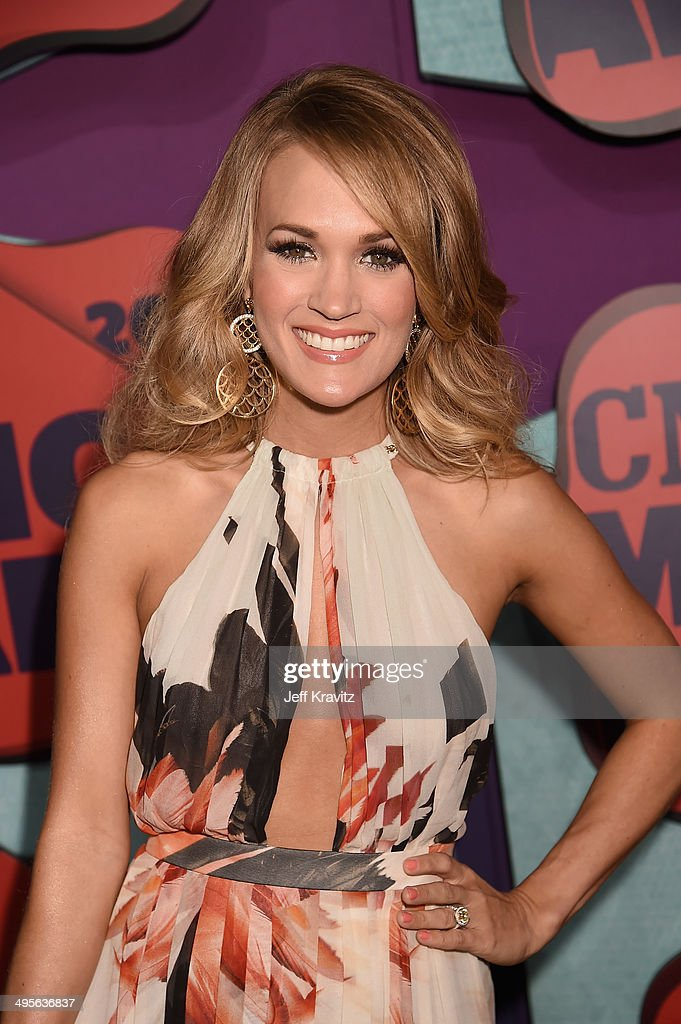 <a gi-track='captionPersonalityLinkClicked' href=/galleries/search?phrase=Carrie+Underwood&family=editorial&specificpeople=204483 ng-click='$event.stopPropagation()'>Carrie Underwood</a> attends the 2014 CMT Music awards at the Bridgestone Arena on June 4, 2014 in Nashville, Tennessee.
