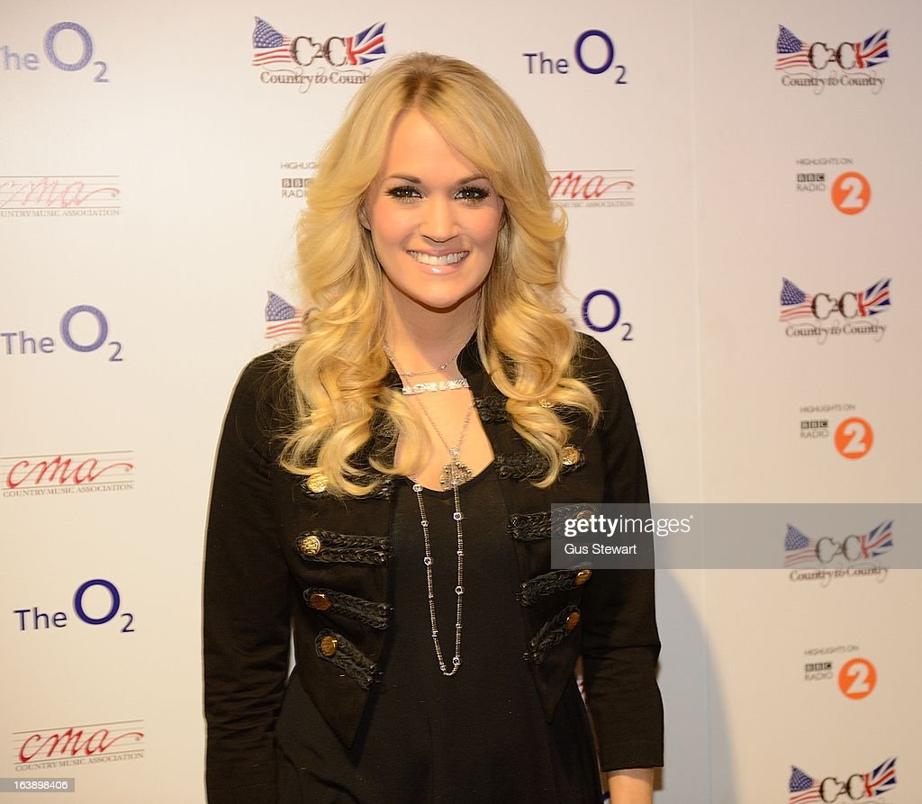 <a gi-track='captionPersonalityLinkClicked' href=/galleries/search?phrase=Carrie+Underwood&family=editorial&specificpeople=204483 ng-click='$event.stopPropagation()'>Carrie Underwood</a> attends the Country 2 Country tour at O2 Arena on March 17, 2013 in London, England.