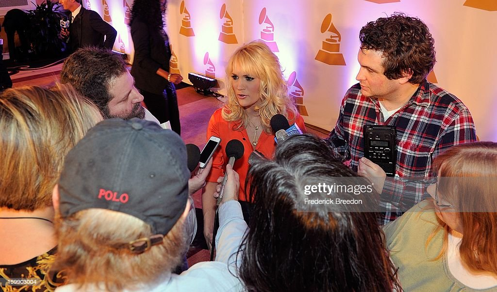 <a gi-track='captionPersonalityLinkClicked' href=/galleries/search?phrase=Carrie+Underwood&family=editorial&specificpeople=204483 ng-click='$event.stopPropagation()'>Carrie Underwood</a> fields questions from the media at the Nashville GRAMMY Nominee Party at the Loews Vanderbilt Hotel on January 22, 2013 in Nashville, Tennessee.