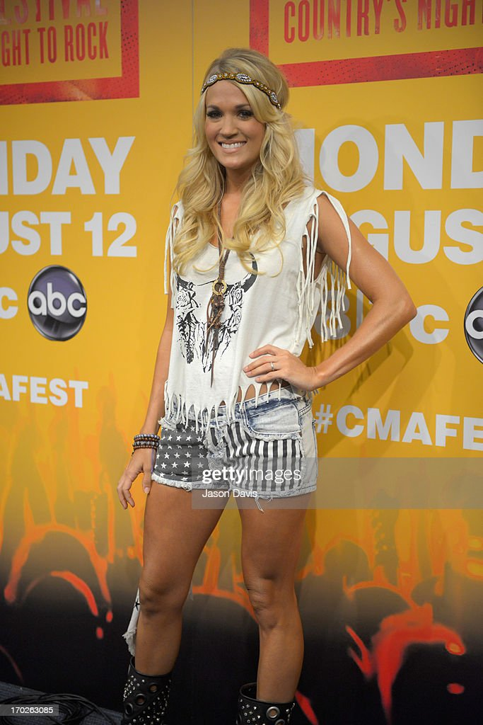 <a gi-track='captionPersonalityLinkClicked' href=/galleries/search?phrase=Carrie+Underwood&family=editorial&specificpeople=204483 ng-click='$event.stopPropagation()'>Carrie Underwood</a> makes an appearance at a press conference during the 2013 CMA Music Festival on June 9, 2013 in Nashville, Tennessee.