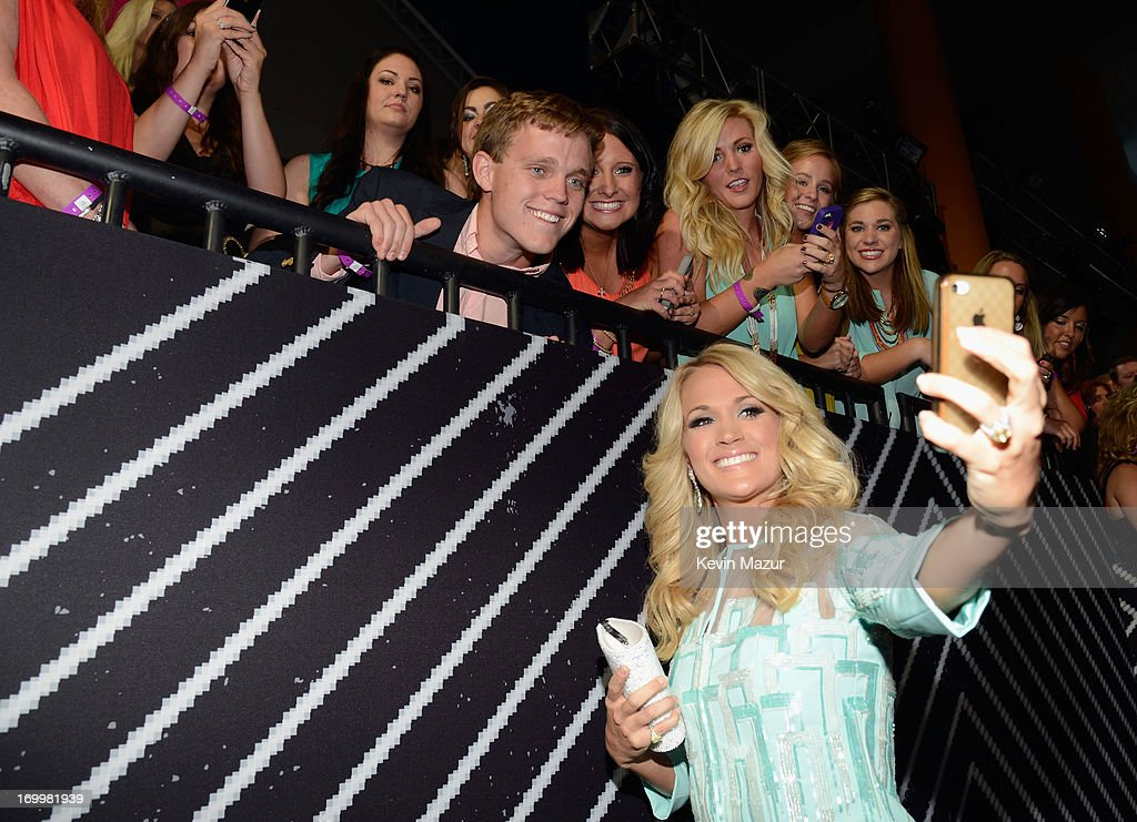 Carrie Underwood meets fans at the 2013 CMT Music awards at the Bridgestone Arena on June 5, 2013 in Nashville, Tennessee.