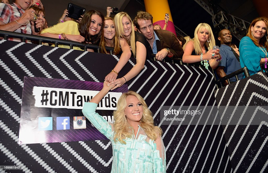 <a gi-track='captionPersonalityLinkClicked' href=/galleries/search?phrase=Carrie+Underwood&family=editorial&specificpeople=204483 ng-click='$event.stopPropagation()'>Carrie Underwood</a> meets fans at the 2013 CMT Music awards at the Bridgestone Arena on June 5, 2013 in Nashville, Tennessee.