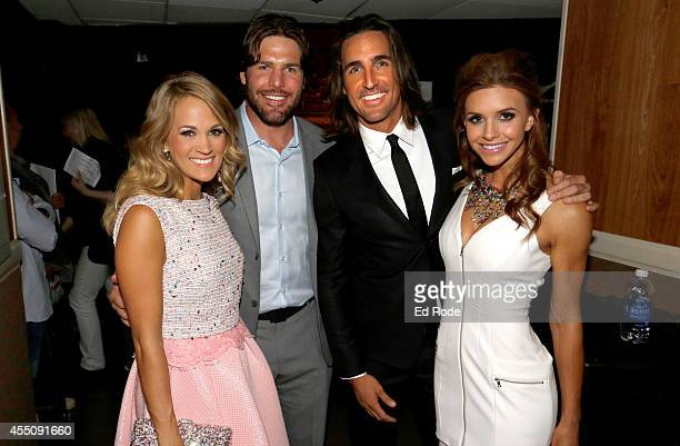 Carrie Underwood Mike Fischer Jake Owen and Lacey Buchanan pause for a photo backstage at the 8th Annual ACM Honors at the Ryman Auditorium on...