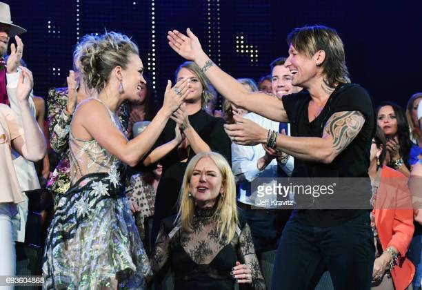 Carrie Underwood Nicole Kidman and Keith Urban attend the 2017 CMT Music Awards at the Music City Center on June 7 2017 in Nashville Tennessee
