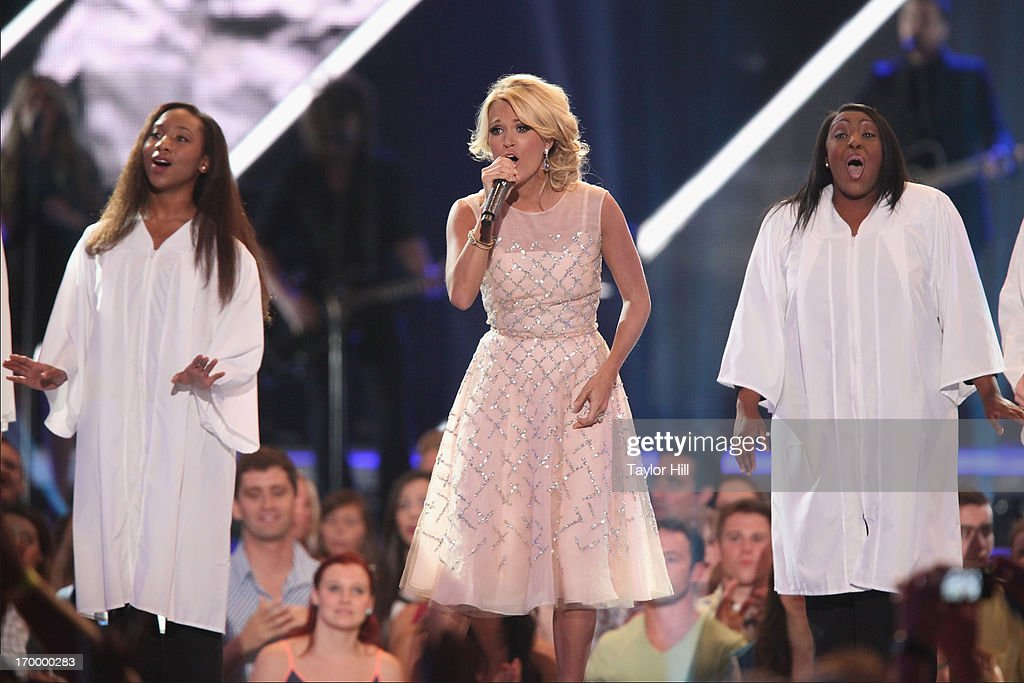 Carrie Underwood performs a tribute to the tornado victims of Moore, Oklahoma during the 2013 CMT Music awards at the Bridgestone Arena on June 5, 2013 in Nashville, Tennessee.
