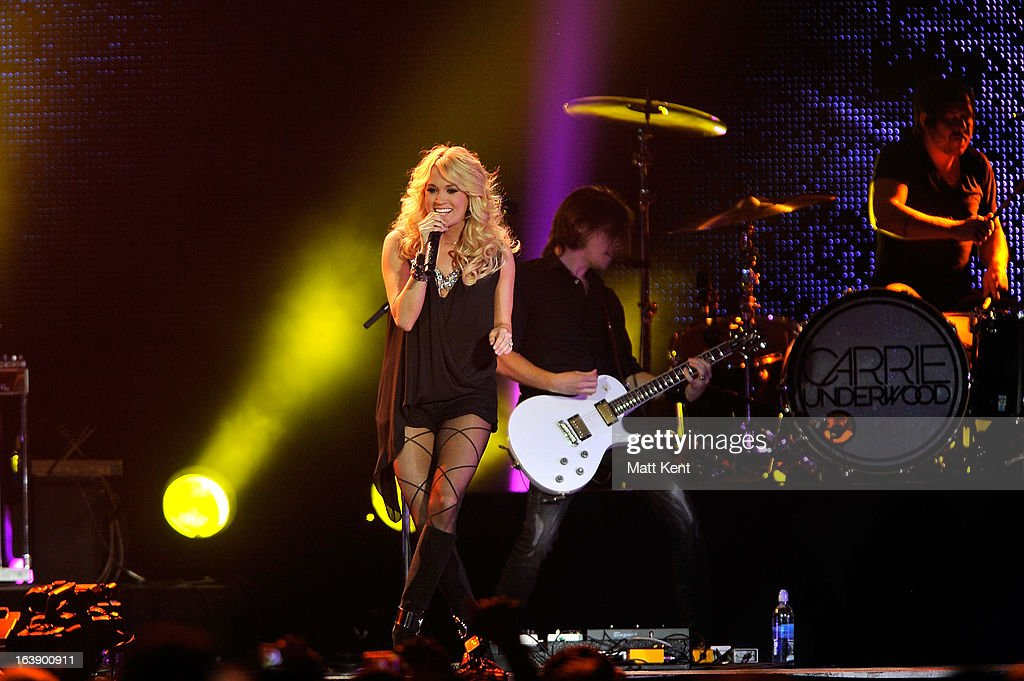 <a gi-track='captionPersonalityLinkClicked' href=/galleries/search?phrase=Carrie+Underwood&family=editorial&specificpeople=204483 ng-click='$event.stopPropagation()'>Carrie Underwood</a> performs as part of the Country 2 Country tour at O2 Arena on March 17, 2013 in London, England.