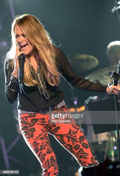 Carrie Underwood performs on stage during Keith Urban's Fifth Annual 'We're All 4 The Hall' Benefit Concert at the Bridgestone Arena on May 6 2014 in...
