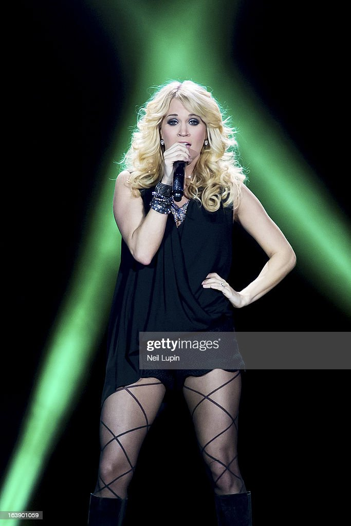 <a gi-track='captionPersonalityLinkClicked' href=/galleries/search?phrase=Carrie+Underwood&family=editorial&specificpeople=204483 ng-click='$event.stopPropagation()'>Carrie Underwood</a> performs on stage on Day 2 of C2C: Country To Country Festival 2013 at O2 Arena on March 17, 2013 in London, England.