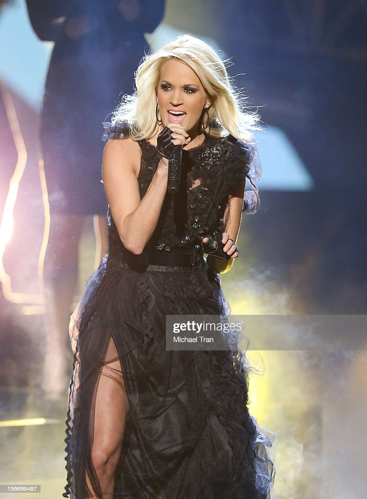 <a gi-track='captionPersonalityLinkClicked' href=/galleries/search?phrase=Carrie+Underwood&family=editorial&specificpeople=204483 ng-click='$event.stopPropagation()'>Carrie Underwood</a> performs onstage at The 40th American Music Awards held at Nokia Theatre L.A. Live on November 18, 2012 in Los Angeles, California.