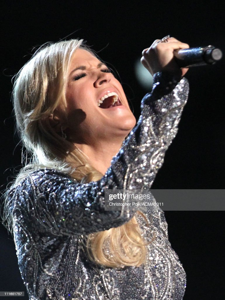 <a gi-track='captionPersonalityLinkClicked' href=/galleries/search?phrase=Carrie+Underwood&family=editorial&specificpeople=204483 ng-click='$event.stopPropagation()'>Carrie Underwood</a> performs onstage during ACM Presents: Girls' Night Out: Superstar Women of Country concert held at the MGM Grand Garden Arena on April 4, 2011 in Las Vegas, Nevada.