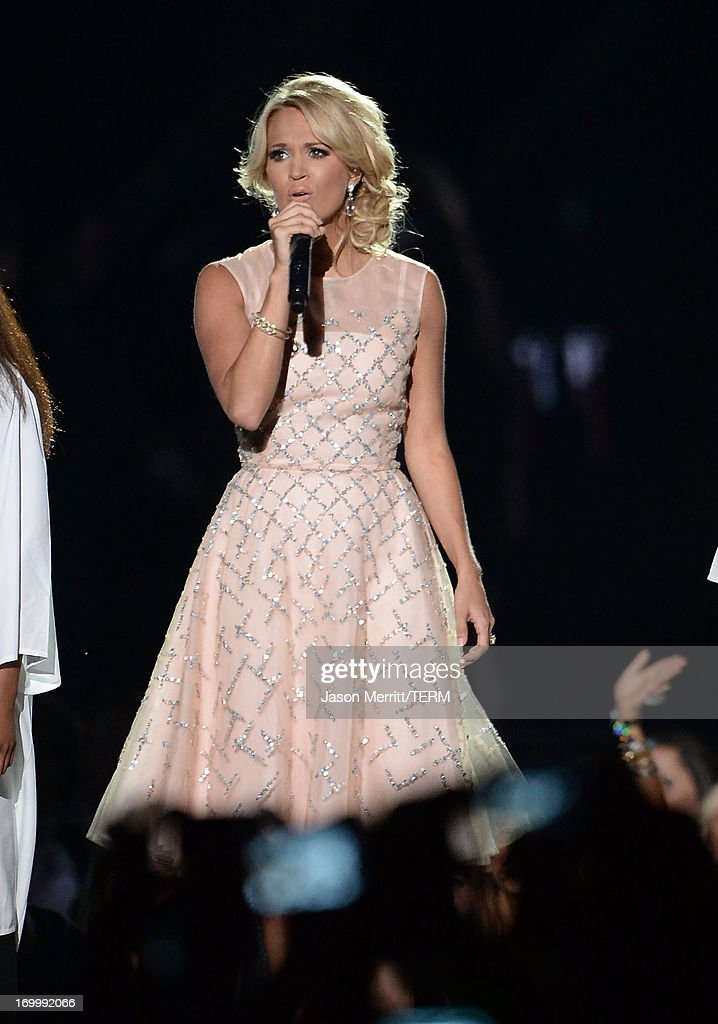 <a gi-track='captionPersonalityLinkClicked' href=/galleries/search?phrase=Carrie+Underwood&family=editorial&specificpeople=204483 ng-click='$event.stopPropagation()'>Carrie Underwood</a> performs onstage during the 2013 CMT Music awards at the Bridgestone Arena on June 5, 2013 in Nashville, Tennessee.