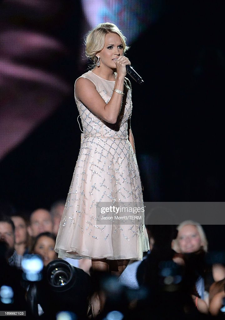 Carrie Underwood performs onstage during the 2013 CMT Music awards at the Bridgestone Arena on June 5, 2013 in Nashville, Tennessee.