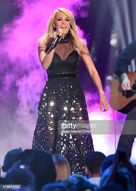 Carrie Underwood performs onstage during the 2015 CMT Music awards at the Bridgestone Arena on June 10 2015 in Nashville Tennessee