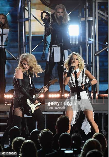 Carrie Underwood performs with Lindsay Ell of her all female band during the 50th annual CMA Awards at the Bridgestone Arena on November 2 2016 in...
