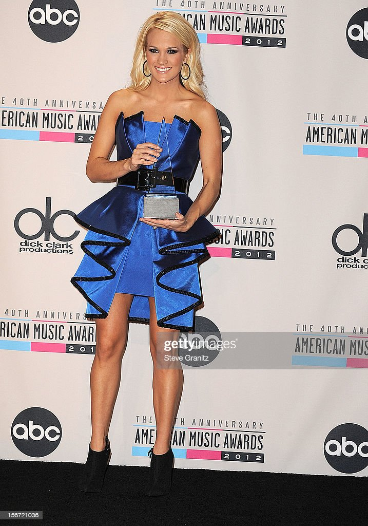 Carrie Underwood poses at the 40th Anniversary American Music Awards at Nokia Theatre L.A. Live on November 18, 2012 in Los Angeles, California.