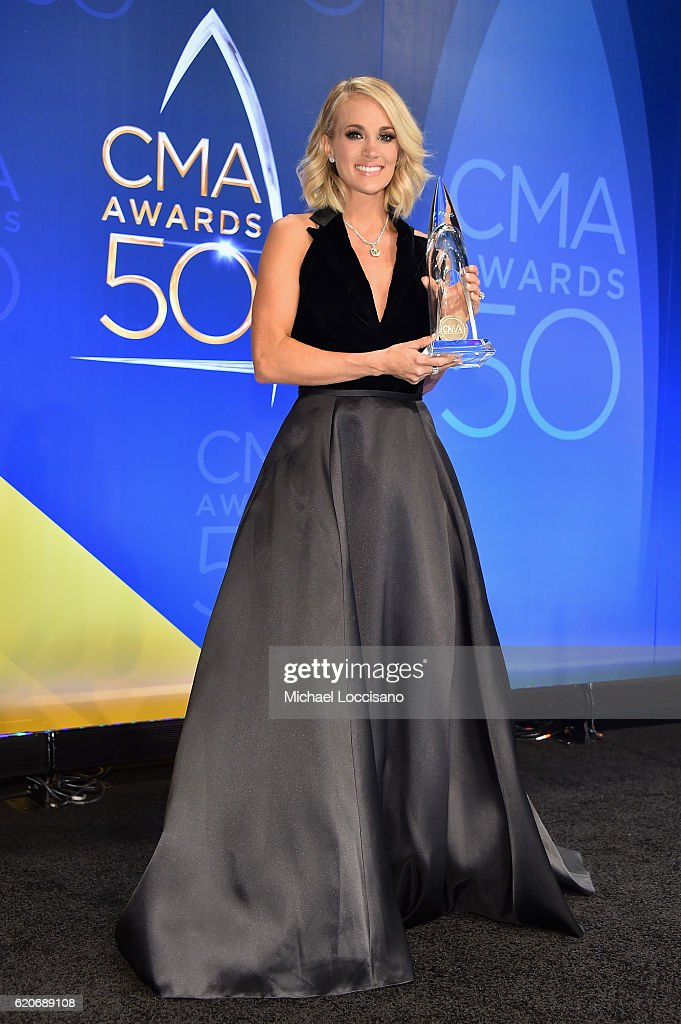 Carrie Underwood poses for a photo in the press during during the 50th annual CMA Awards at the Bridgestone Arena on November 2, 2016 in Nashville, Tennessee.