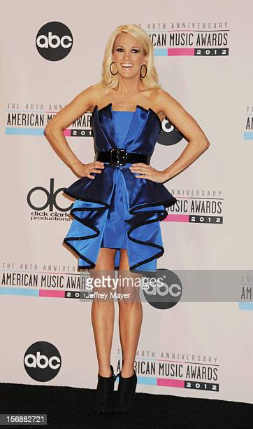 Carrie Underwood poses in the press room at the 40th Anniversary American Music Awards held at Nokia Theatre LA Live on November 18 2012 in Los...
