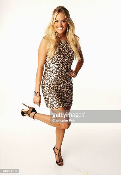 Carrie Underwood poses in the Wonderwallcom Portrait Studio during 2012 CMT Music awards at the Bridgestone Arena on June 6 2012 in Nashville...