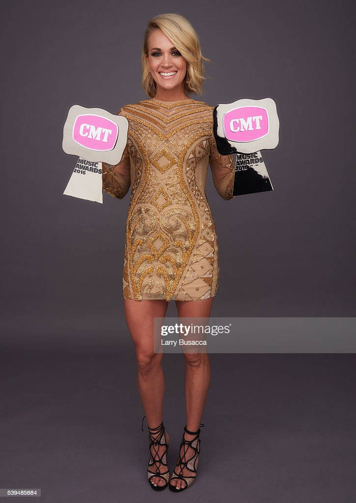 "Carrie Underwood poses with CMT Awards for Female Video ""Smoke Break"" and CMT Performance of the Year ""Smoke Break"" in the 2016 CMT Music Awards..."