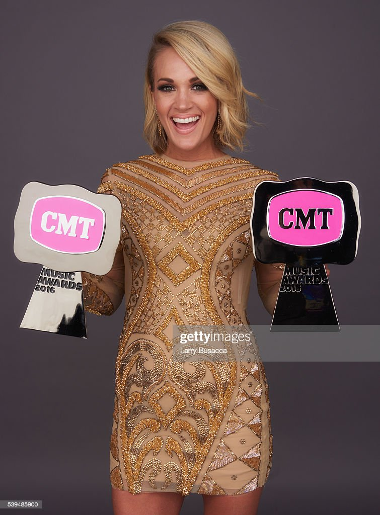 """Carrie Underwood poses with CMT Awards for Female Video """"Smoke Break"""" and CMT Performance of the Year """"Smoke Break"""" in the 2016 CMT Music Awards..."""